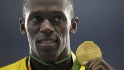 Usain Bolt devolvió medalla retirada por positivo de compañero